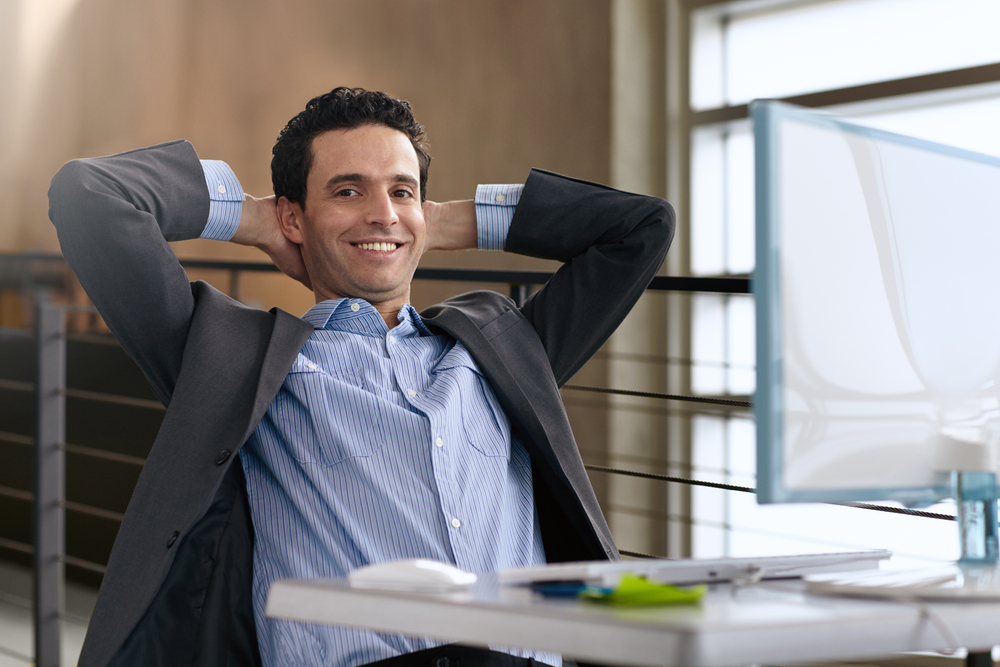 Portrait of a confident businessman at work in his glass office